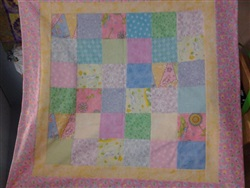 Roselle did this adorable quilt using a flannel charm pack, with flannel for borders, and flannel backing.